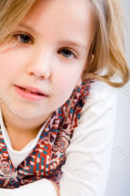 Blond child awaiting an answer