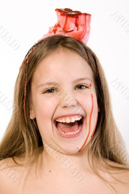 Blond child with desert on her head laughing