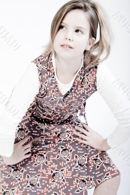 Blond child looking up fashionably