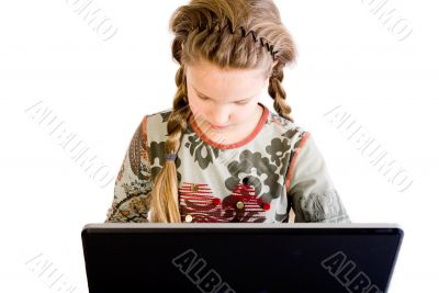 Blond child concentrated with notebook