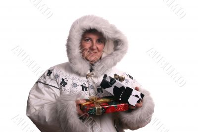 mature woman with winter coat and presents