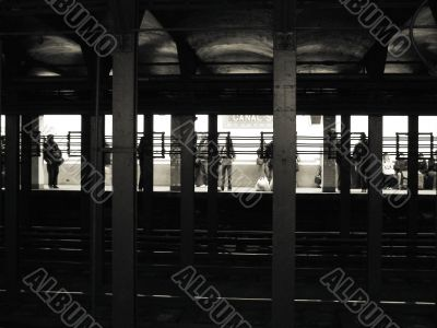 Passengers Waiting in New York City Subway Station