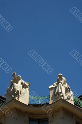 Prague rooftop statues on historic building