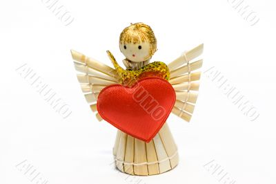 The angel made of straw, with the big gold bow and red heart in