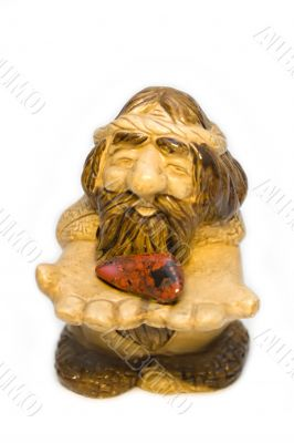 Figurine of the old man with stone heart in hands