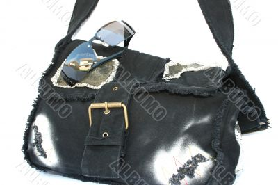 Bag and eyeglasses