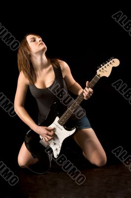Ecstatic rock guitarist woman