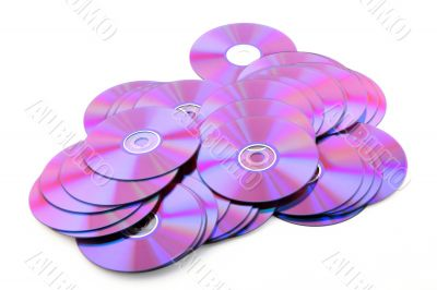 Pile of colorful DVDs or CDs on white background