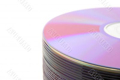 Close-up of stacked purple DVDs