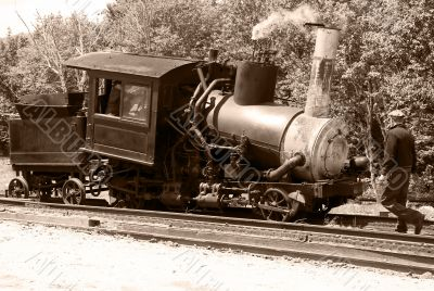 Antique steam train and railroad worker