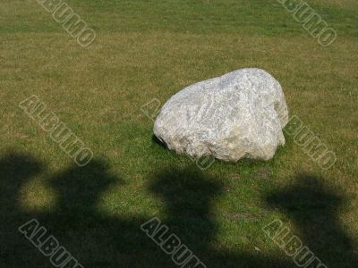 Lonely White Stone over Green Grass Garden