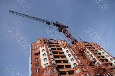 Construction of a new multi-storey brick building.