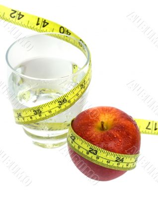 Glass of Water and Red Apple