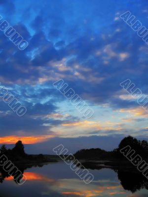 sunset sky in blue and rose clouds