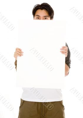 casual guy hiding behind a white board