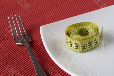 Fork, plate and a measure tape
