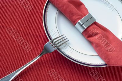 fork, plate and napkin