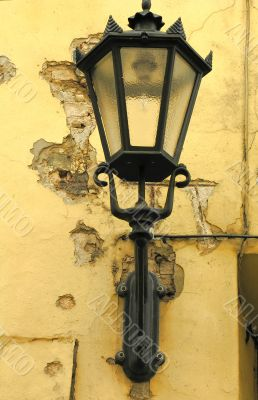 Old metallic lantern on the wall