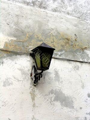 Old metallic lantern on the grunge wall