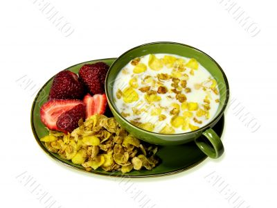 Cornflakes and milk on a white background