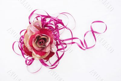 red artificial rose convoluted in purple tape 1