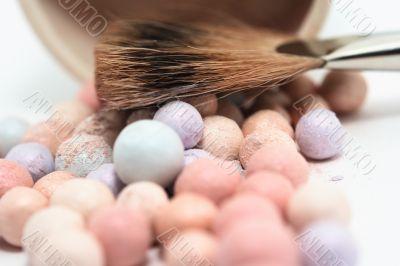 Brush near little rainbow balls