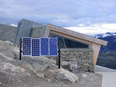 Solar panels on mountain peak