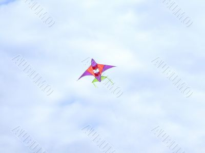 Flying kite in a blue sky