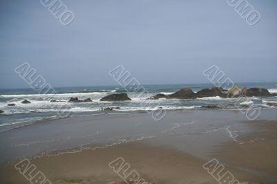 Waves breaking on volcanic rocks