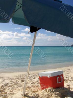 Box and umbrella on the beach