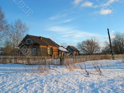 Winter evening in village