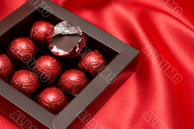 Chocolate Valentines truffles in red paper