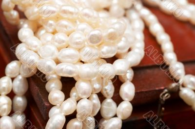 White real river pearls on wooden box