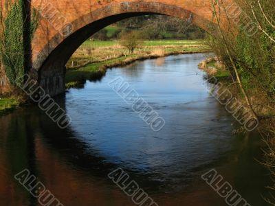 river flowing under the bridge