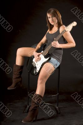 Young female rock guitarist