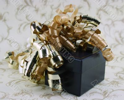 Blue Box with Curly Gold Ribbons