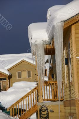 Large icicles on Townhouses after heavy snowstorm