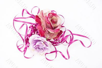 two artificial roses, convoluted in purple tape