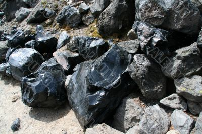 Obsidian boulders from lava flow