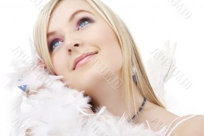 happy blond angel girl with feather boa