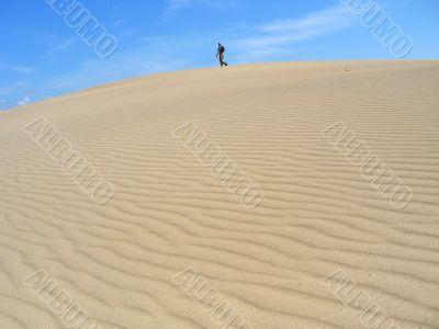man on dunes. desert landscape