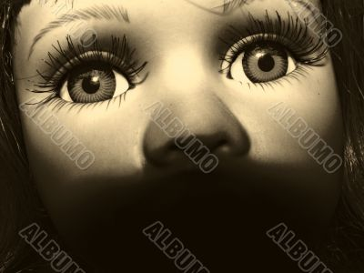 the face of toy doll. sepia