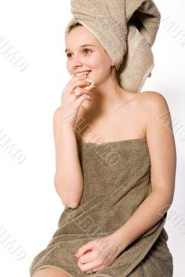 Young girl eating a mandarin