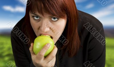 Girl eating delicious green apple