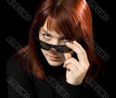 Girl with sunglasses staring at camera