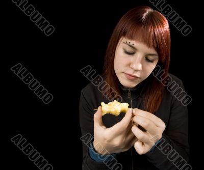 Girl eating apple.