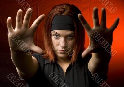 Teenager with her hands against the camera