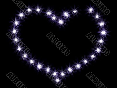 Heart from shining stars on a black background