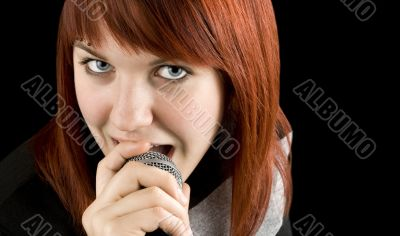 Girl singing karaoke on microphone