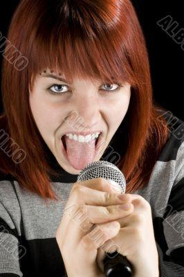 Redhead girl screaming in microphone